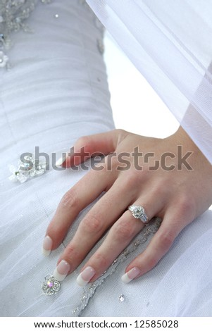 A bride standing with her hand on her hip - stock photo