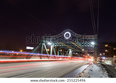 A bridge in East Toronto with the blur of traffic at night - stock photo