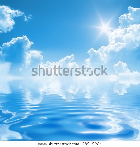 a bright blue sky with clear water - stock photo