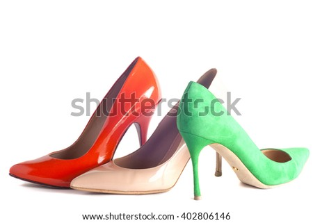 A bright, multicolored female shoes on high heels isolated on white background - stock photo