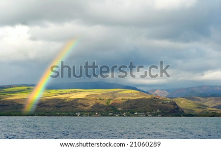 A bright rainbow over the little town of Waimea on the southern coast of Kauai