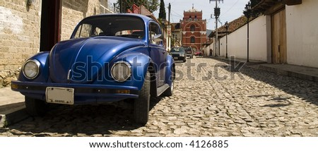 a bright volkswagen beetle at mexico's typical streets - stock photo