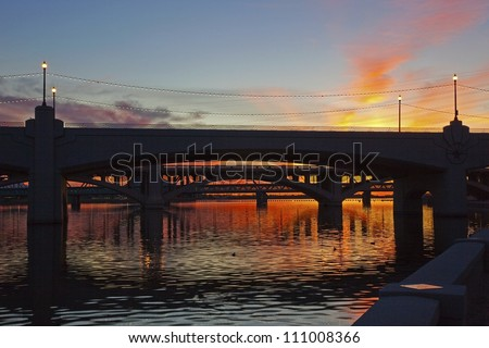 A brilliant sunset on the Tempe Town Lake and it's bridges - stock photo
