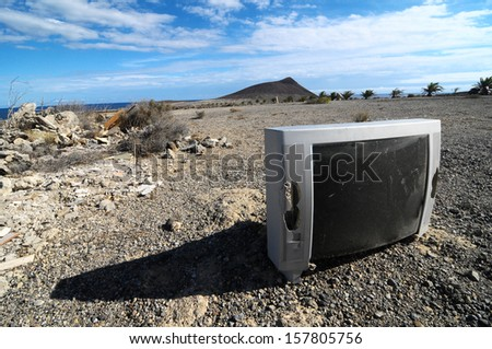 A Broken Gray Television Abandoned in the Desert
