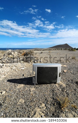 A Broken Gray Television Abandoned in the Desert - stock photo