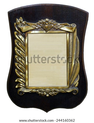 A bronze Sign on wooden shield - stock photo