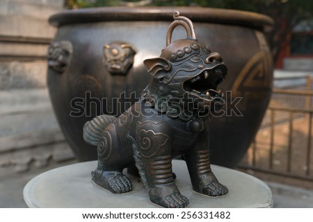 A bronze statue of a Chinese ancient dog in the Summer Palace, Beijing, China - stock photo
