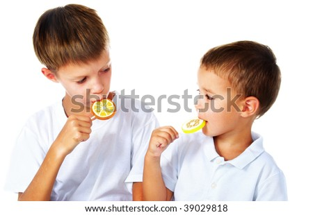 a brothers with two lollipops - stock photo