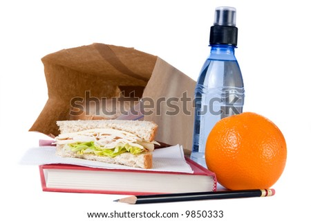 A brown bag school lunch, with fruit and water - stock photo