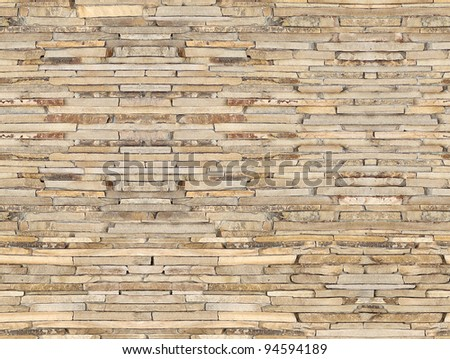 A brown brick wall (repeated background) - stock photo