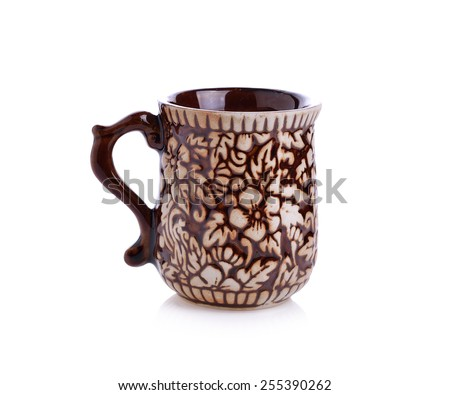 A Brown coffee cup on white background with  - stock photo