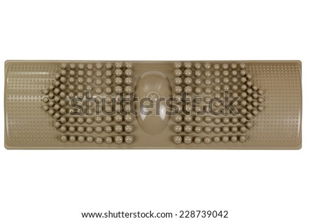 A brown foot massage plastic pad for a self reflexology treatment - stock photo
