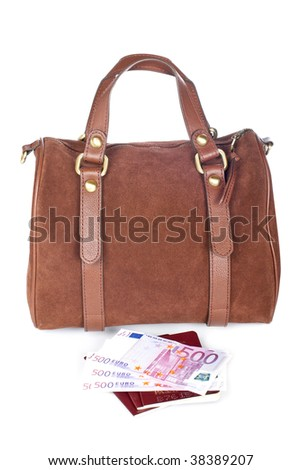 A brown handbag with two passports and money, isolated on white background