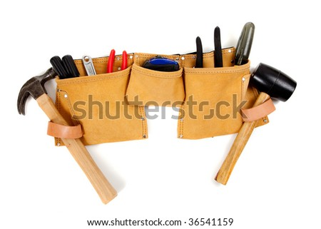 A brown leather toolbelt with assorted tools including a hammer, screwdrivers, pliers, tape measure etc. - stock photo