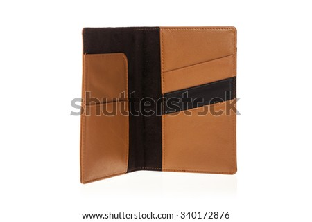 A brown leather wallet inside with pocket for money, passport closeup isolated white.