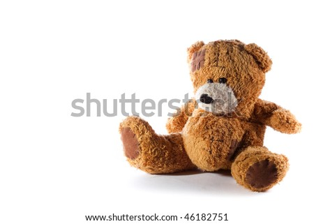 a brown teddy bear with patch on a head sited on white from the side