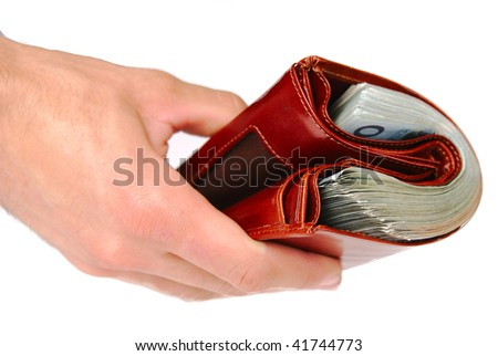 A brown wallet full of money isolated on white background - stock photo