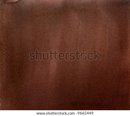 A brown watercolor wash on heavy toothed paper, suitable as a background texture. - stock photo