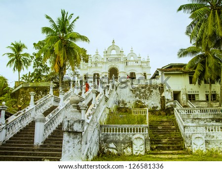 A buddhism temple complex on a mountain in the jungle of the tropical island Sri Lanka near the village Dodanduwa in the Southwest of the island. - stock photo