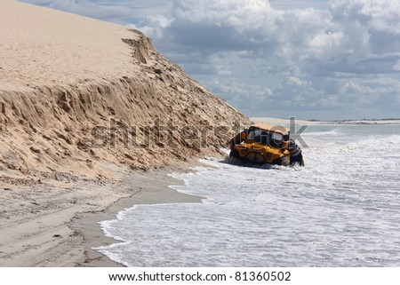 A buggy stuck on a beach in northeast Brazil - stock photo
