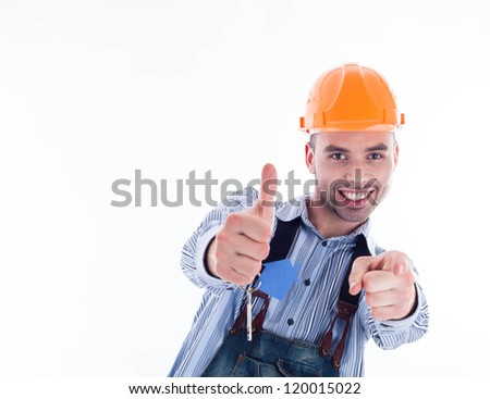 A builder man holding a key and a paper house. - stock photo