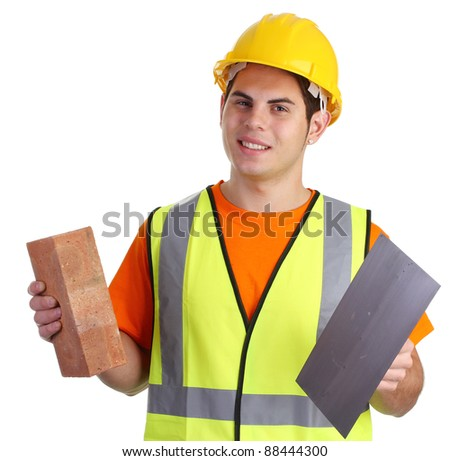 A builder with a brick and tools. - stock photo