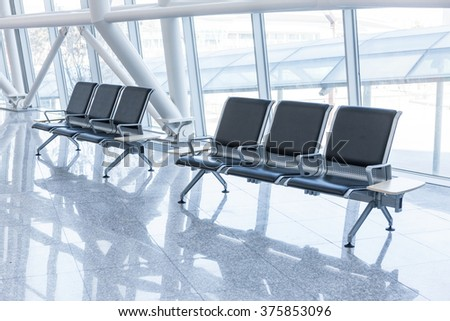 A building of glass and public chairs interior for exhibition, convention close up day light. - stock photo