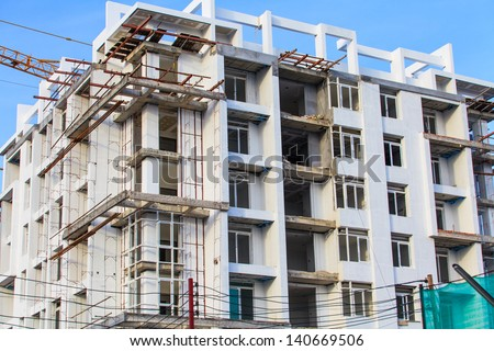 A building under construction with blue sky. - stock photo