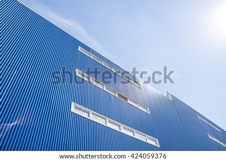 A building with blue windows of metal