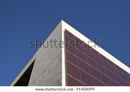 a building with hundreds of solar panels on the facade - stock photo