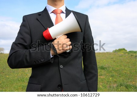 A buiness man holding a megaphone - stock photo