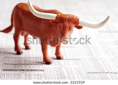 A bull on a financial newspaper - stock photo