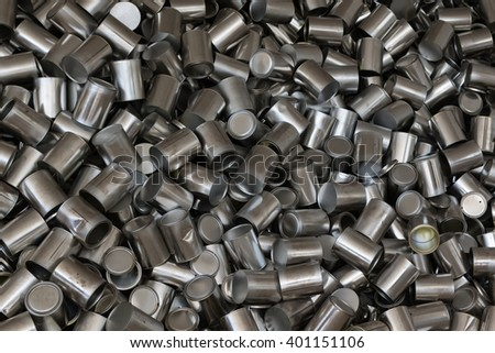 A Bunch of Aluminum Can Coming Out from Dark Hole from Ceiling in White Room - stock photo