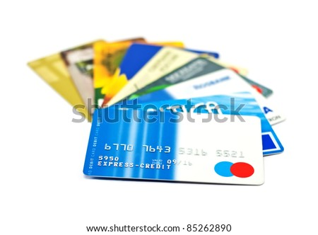A bunch of credit cards over white - stock photo