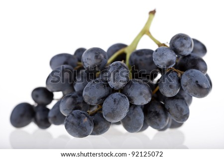 A bunch of grapes isolated on a white background - stock photo