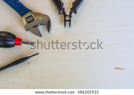 A bunch of isolated tools isolated on wood background