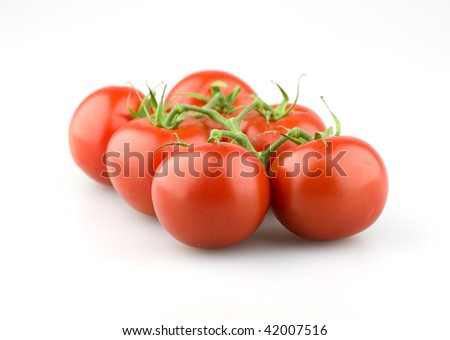 A bunch of juicy tomatoes with stem on a white background. - stock photo