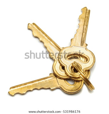 A bunch of keys isolated on white background. Flat lay, top view.