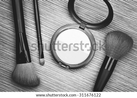A bunch of make-up brushes and Cosmetics, Set of makeup brush and contour palette, Women accessories. (Black & White) - stock photo