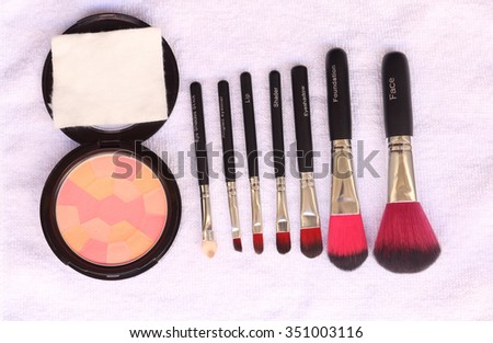 A bunch of make-up brushes and Cosmetics, Set of makeup brush and contour palette, Women accessories.  - stock photo