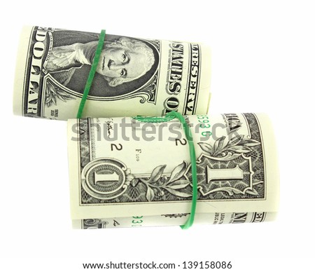 A bunch of one American Dollars money notes rolled up and held together with a simple rubber band. - stock photo