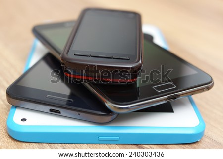 a bunch of phones and tablet computer - stock photo