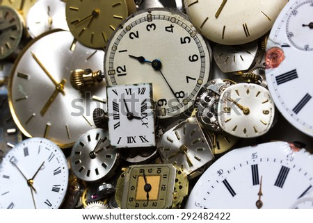 a bunch of pocket watch clockworks