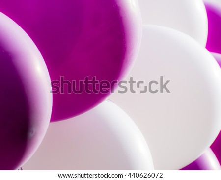 A bunch of purple and white balloons - stock photo