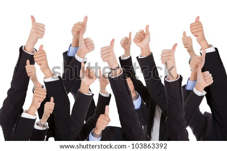 A bunch of raised hands of business people. Isolated on white - stock photo