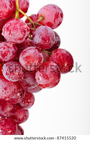 A bunch of red grapes on a white background. - stock photo