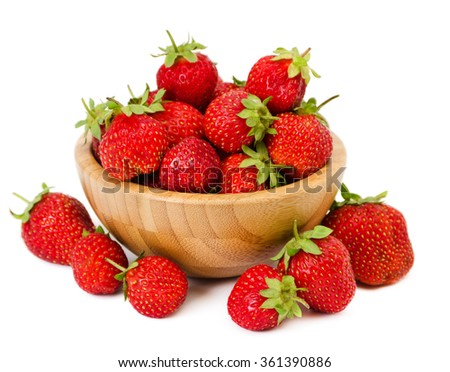 a bunch of ripe strawberries in a wooden bowl isolated on a white - stock photo