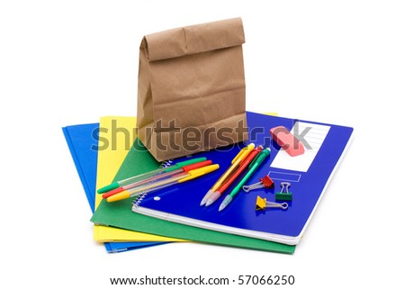 A bunch of school supplies with paper bag lunch, back to school - stock photo