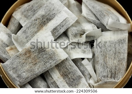 A bunch of swedish snus in a round container - stock photo