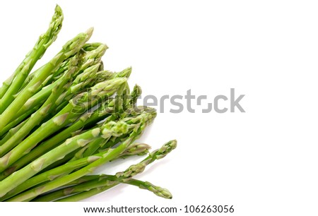 A bunch of young fresh asparagus over white background - stock photo
